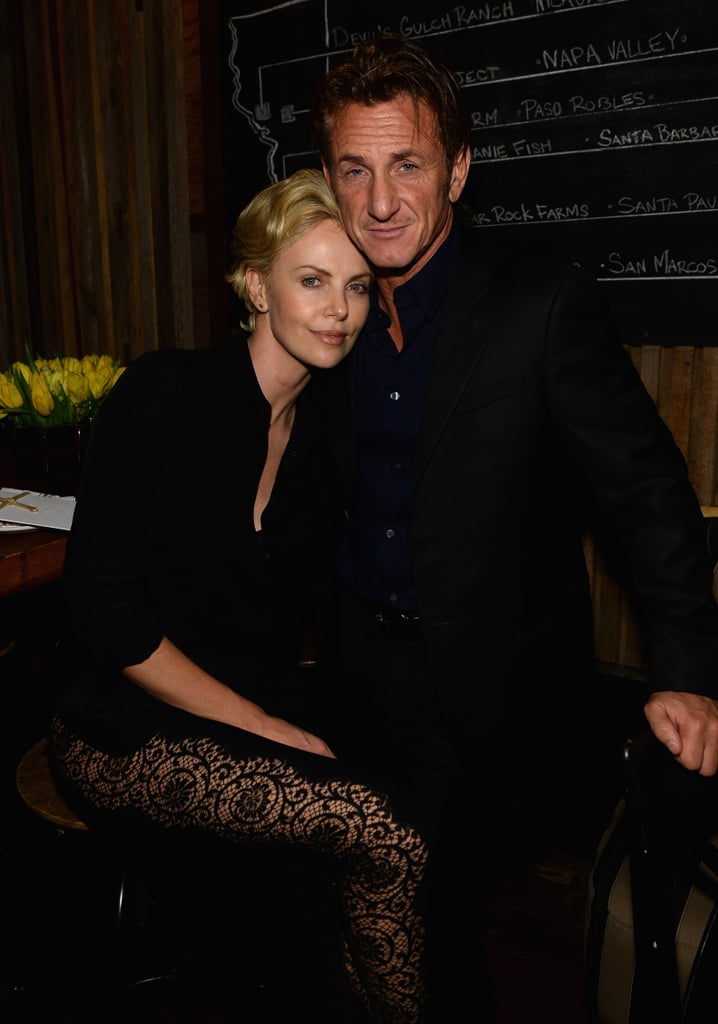 Charlize Theron cuddled up to Sean Penn at Pharrell Williams's pre-Oscars bash on Thursday.