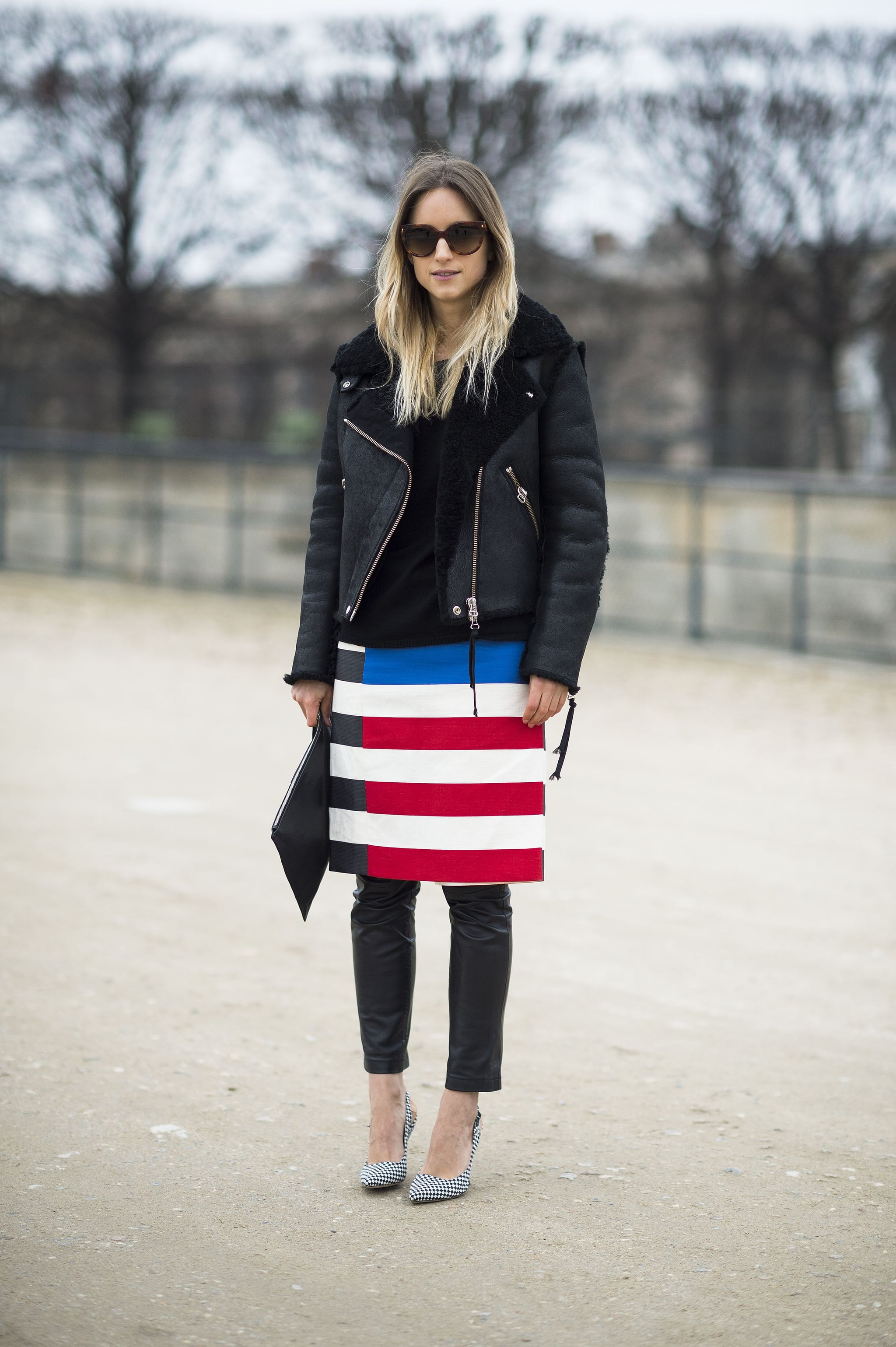 This attendee offset statement stripes with leather and an oversize leather jacket. Source: Le 21ème   Adam Katz Sinding