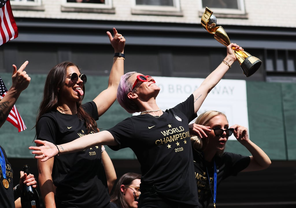 "Champagne and confetti are in store for the US Women's National Soccer Team. The 23 kickass players came home after their historic World Cup win — here's a list of records the team broke if you need a refresher. They've been celebrating ever since, and July 10 marked a crowded and well-deserved ticker-tape parade in Lower Manhattan. On the US floats, clad in sunglasses, medals, and ""World Champion"" t-shirts, stood Megan Rapinoe, who won the coveted Golden Boot for most goals and Golden Ball for the best player in the tournament, along with teammates Alex Morgan (Silver Boot winner) and Rose Lavelle (Bronze Ball winner). Greats like Carli Lloyd and Julie Ertz joined them. If you missed the parade, there was lots of confetti (duh) and power poses. Also, team members, including Crystal Dunn, started an ""equal pay"" chant. We'd expect nothing less from the group whose platform at the World Cup brought attention to the US Soccer Federation gender pay gap. At one point, Alex sprayed the crowd with Champagne — which, if we could guess, felt like being showered with fearlessness. At a ceremony after the parade, Megan was the last person to speak for her team. Addressing the crowd at New York City Hall, the 34-year-old cocaptain said, ""This is my charge to everyone: we have to be better. We have to love more, hate less. We have to listen more and talk less."" She went on to say, ""It's our responsibility to make this world a better place. I think this team does an incredible job of taking that on our shoulders and understanding the position that we have and the platform we have. Yes, we play sports; yes, we play soccer; yes, we're female athletes, but we're so much more than that. You're so much more than that."" She challenged everyone to step outside of themselves to do good in their communities. Ahead, check out pictures from the celebrations that will warm your heart and make you even more proud of these great women.      Related:                                                                                                           Why Calling the USWNT ""Arrogant"" Is Not Only Pretty Sexist, but Also Blatantly False"