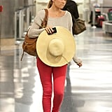 Lauren Conrad rocked red pants with her wide-brimmed hat.