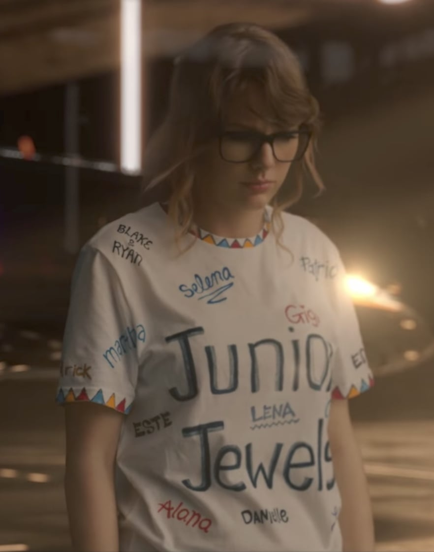 what are the names on taylor swift 39 s shirt in music video