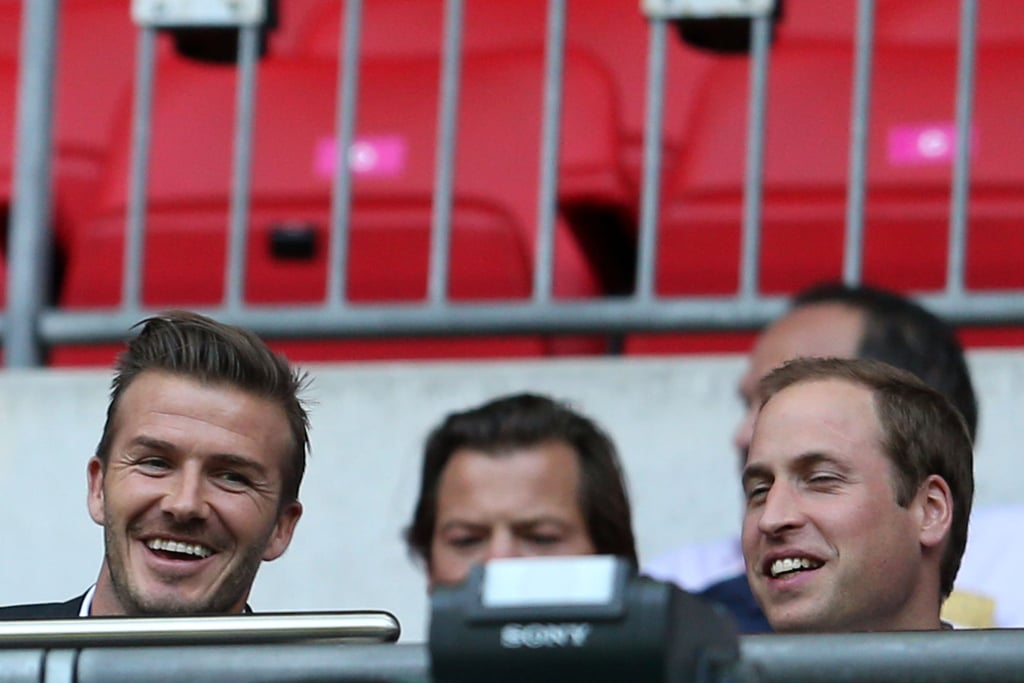 Prince William and David Beckham cheered on Team GB at a soccer match on day two.