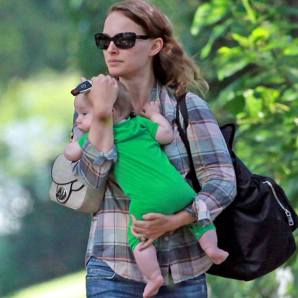 Natalie Portman carries baby Aleph to the car.
