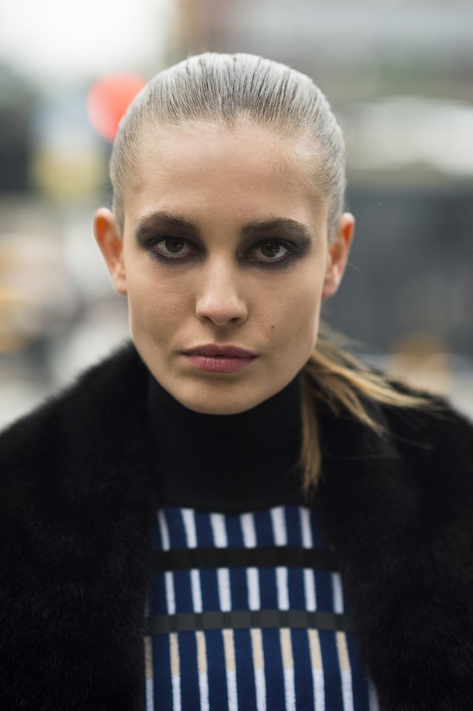 Model Nadja Bender went for full-on bold with a black smoky eye and sleek ponytail. Source: Le 21ème | Adam Katz Sinding