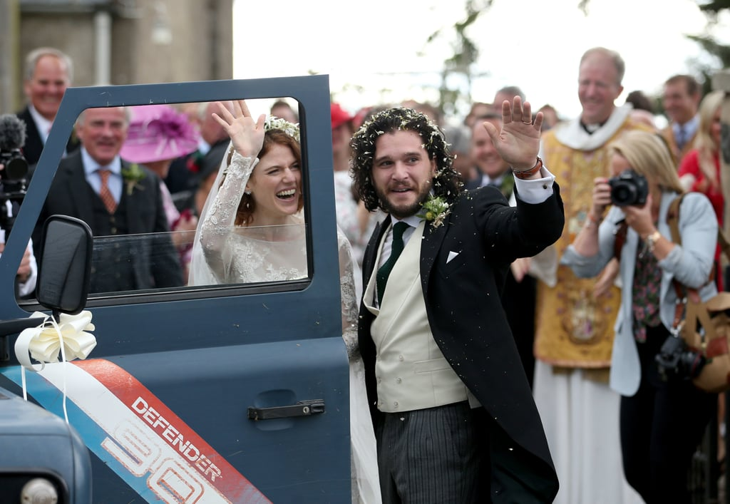 It's a Game of Thrones wedding! Kit Harington and Rose Leslie tied the knot on June 23, in Aberdeenshire, Scotland, at Rose's childhood estate.  The couple met while playing love interests on the HBO show and revealed their engagement in 2017. Many of their costars traveled to Scotland to help Kit and Rose celebrate, including Emilia Clarke, Sophie Turner, Maisie Williams, and Peter Dinklage. Ahead, see our favorite snaps from the pair's special day, including photos of the couple beaming as they run through flower petals together. Jon Snow may know nothing, but Kit and Rose sure do know a thing or two about love.
