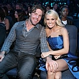 Mike placed a hand sweetly on Carrie's knee at the American Music Awards in LA in 2012.