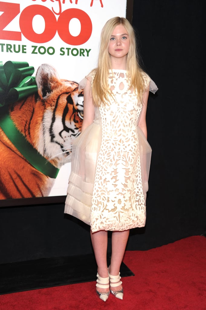 Elle Fanning put her hands in her dress pockets.