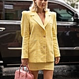 Give off Cher Horowitz vibes in yellow plaid suiting.