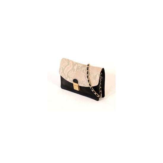 Small enough to look elegant and big enough for all my race day essentials— this clutch is as timeless as it is practical. — Marisa, publisher Bag, $450, Benah