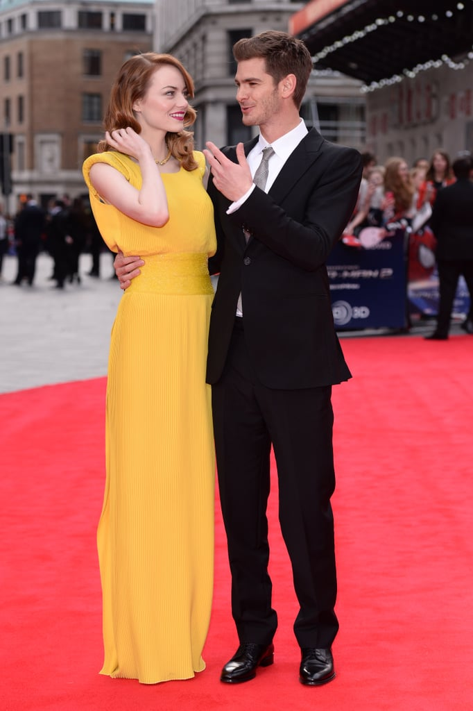 If you needed more proof that Andrew Garfield and Emma Stone are one of the world's cutest couples, here it is: the ridiculously good-looking twosome hit the red carpet together for the London premiere of The Amazing Spider-Man 2 on Thursday and were basically the epitome of a movie star couple. Andrew looked dapper as ever in a suit and tie, while Emma channeled Michelle Williams in a bright yellow Atelier Versace gown. They gave each other sweet smiles and shared a few laughs then posed for photos with their costars Jamie Foxx and Dane DeHaan.  Emma and Andrew have been on a roll lately, as they've been traveling the globe — along with the hilarious Jamie — to promote the highly anticipated sequel before it hits theaters on May 2. During a stop on The Ellen DeGeneres Show last week, Andrew and Emma got grilled on their chemistry in the films but made sure not to give too much information away about their real-life relationship. The couple has also been spending extraspecial time with their smallest fans around the world, including a silly-string-covered press conference in Tokyo and an adorable Earth Hour event in Singapore.