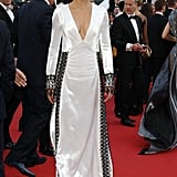 Adriana Lima stunned in a white-with-black-trim gown at the Julieta premiere.