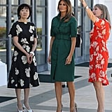 During a tour of the Flagler Museum in Palm Beach on April 18 with Akie Abe (wife of the Japanese Prime Minister Shinzō Abe), Melania wore a green utilitarian dress from Derek Lam and a pair of Christian Louboutin heels.