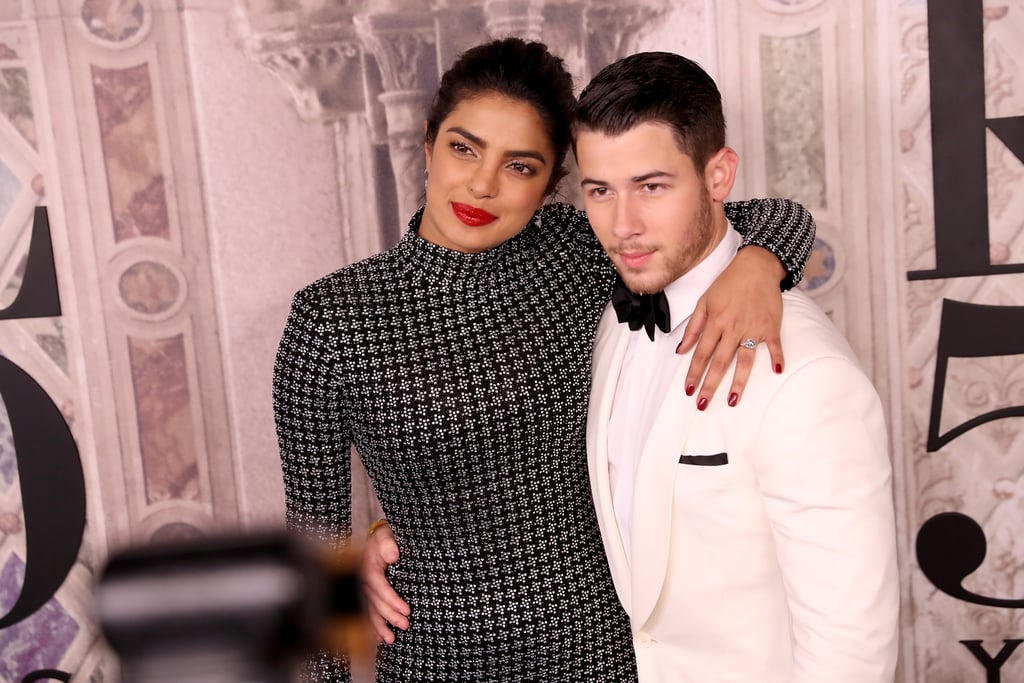 The look of love is strong between Priyanka Chopra and Nick Jonas. On Thursday, the recently engaged couple walked the red carpet together for the first time since announcing their upcoming marriage last month, and they couldn't take their eyes off of each other. This is actually the duo's first-ever official red carpet appearance as a couple — they were just friends during their trip to the 2017 Met Gala. Priyanka and Nick stayed close and cosy together as they giggled together at the Ralph Lauren 50th anniversary celebration for New York Fashion Week, and he even took a second to whisper a little something into her ear. This is date night done right!  While Priyanka and Nick have only been together for a few short months, they seem to be making the most of every outing they have together. The stunning couple already share tons of cute moments, including double dates with Nick's brothers Kevin and Joe and trips to India to meet Priyanka's family. Check out more photos of their sweet night out ahead. Sparks are always flying when they're around.
