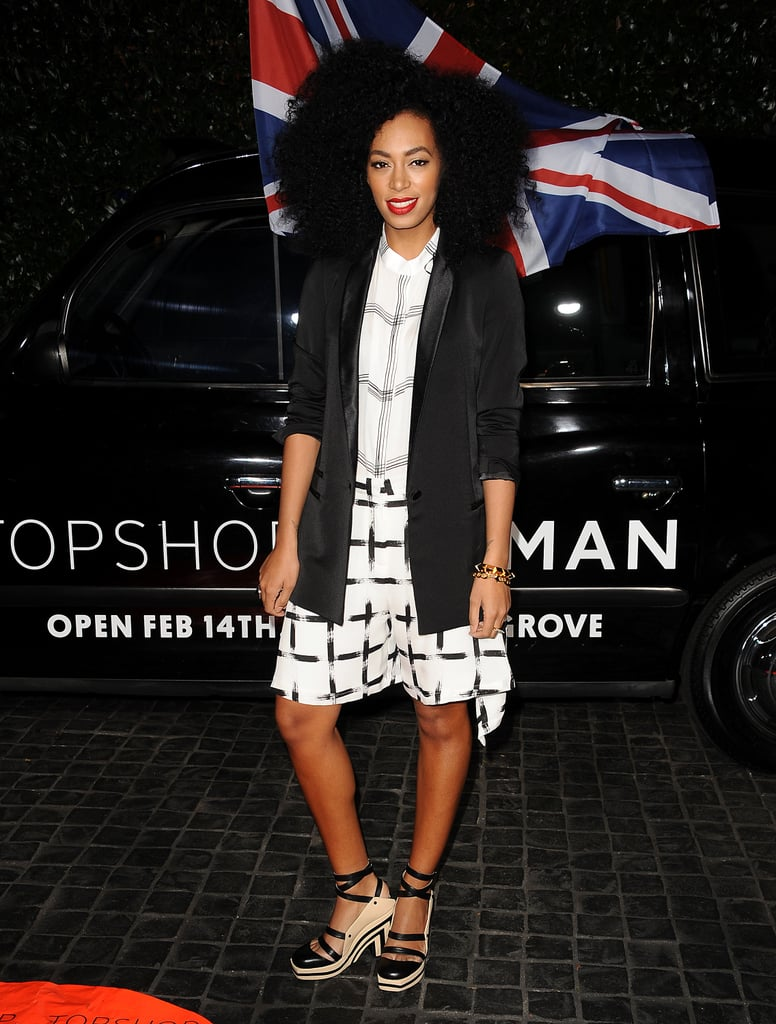 Solange Knowles stuck with her signature printed look, this time in a slightly deconstructed approach to windowpane prints. She partnered the look with a long black blazer and strappy platform sandals.