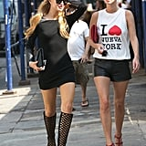 Paris and Nicky Hilton stayed cool in knee-high cage boots and a 3.1 Phillip Lim t-shirt, respectively.