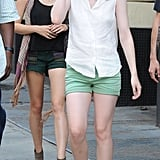 Dakota Fanning accessorized her outfit with minimal jewelry and sunglasses.