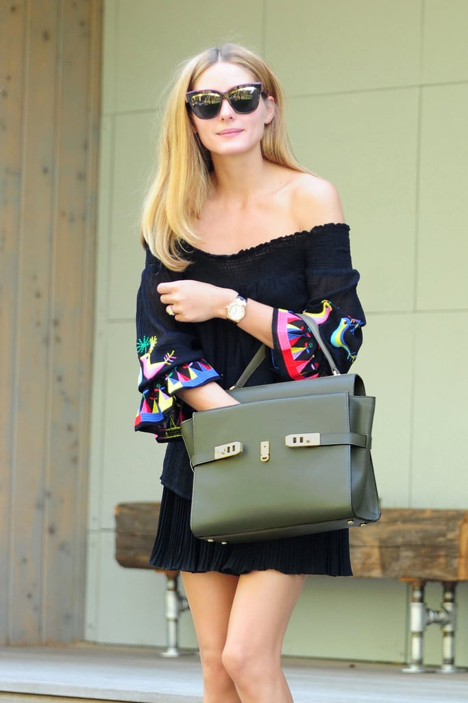 We love the sophistication her Henri Bendel Uptown satchel adds to the overall look.
