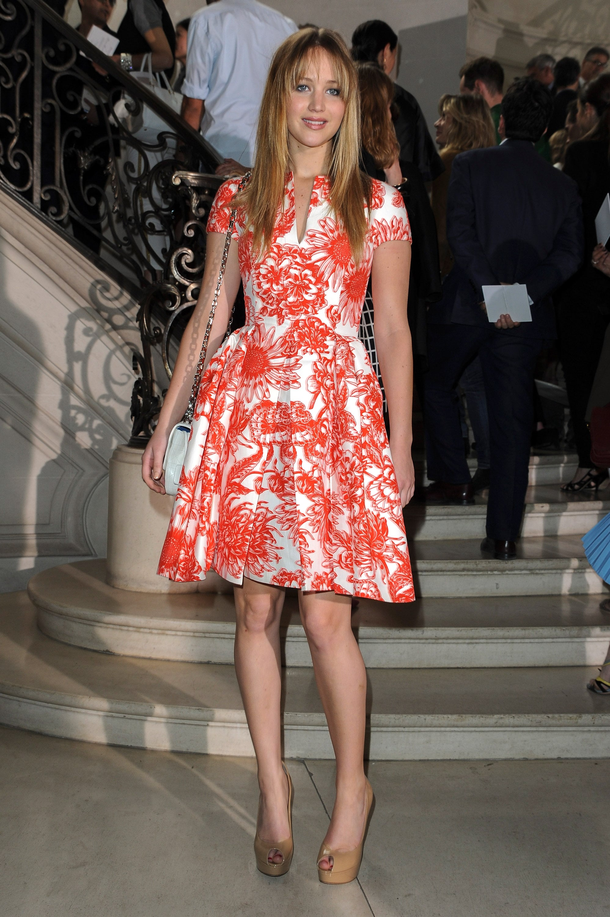 This is what happens when ladylike meets cool-girl chic. How fabulous is the red pattern on this cocktail dress she wore to the Dior Couture Fall 2012 show?