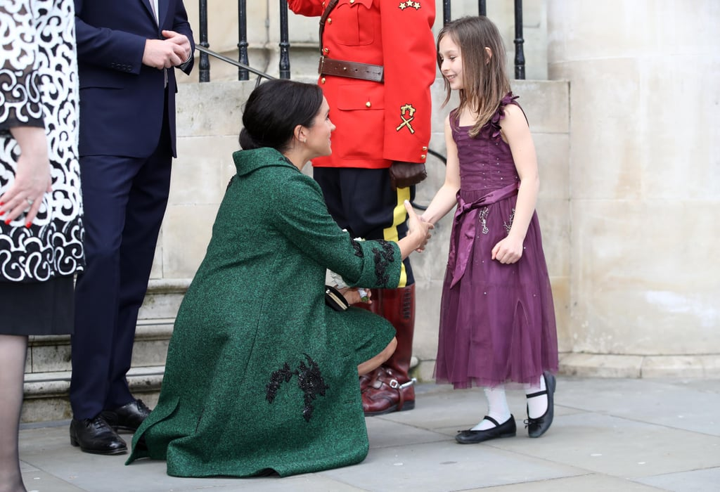 "Meghan Markle may be nearing the end of her pregnancy, but she's not letting her growing belly stop her from literally getting on kids' levels. On Monday, after making traditional maple taffy with a group of little ones at Canada House in London, the Duchess of Sussex and Prince Harry looked delighted to greet a young girl and boy outside of the building. The young girl excitedly handed Meghan a bouquet of flowers and went into a full curtsy, which elicited a round of ""awws"" from the crowd nearby. The cuteness continued when the young boy followed up, handing Meghan another posy and giving her a small bow. It was so adorable, even Harry was beaming.  Both Meghan and her sister-in-law Kate Middleton make it a point to spend extra time talking to children on their engagements and walkabouts, especially with young girls; most recently, Meghan spoke of her commitment to education equality for young women and girls during a panel on International Women's Day, and Kate put her plaiting skills on display while visiting a group of little girls in Northern Ireland. Keep reading for photos and video of Meghan's sweet moment, then find out who she has to curtsy to."