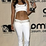Wearing belted jeans with a Sean John belly shirt and bandana at the MTV Video Music Awards in NYC in 2000.