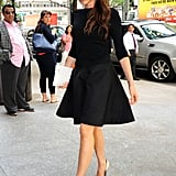 Vitoria arriving to her hotel in New York in a fluted mini and pumps in 2013.