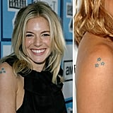 Sienna Miller has a set of three stars in a triangle shape on her upper right arm for at least six years.