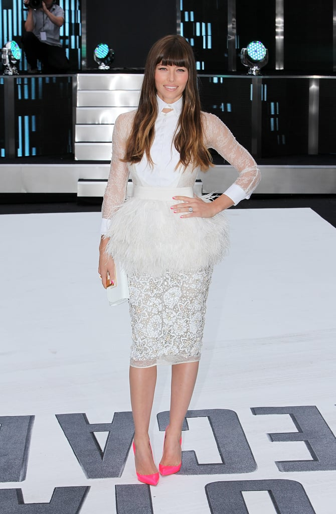 Jessica Biel kept to her dramatic texture M.O. at the London premiere, and this white Giambattista Valli Couture ensemble may take top prize in the category. It's sheer, lacy, feather-infused, features a sharp-pointed collar, and has a peplum silhouette. If that didn't get your attention, her neon pink Christian Louboutin pumps should.
