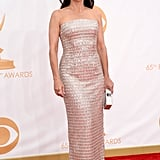 Julia Louis-Dreyfus picked a shimmery Monique Lhuillier column gown and an Edie Parker clutch.
