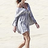 Cindy Crawford covered up her swimsuit with a sheer dress.