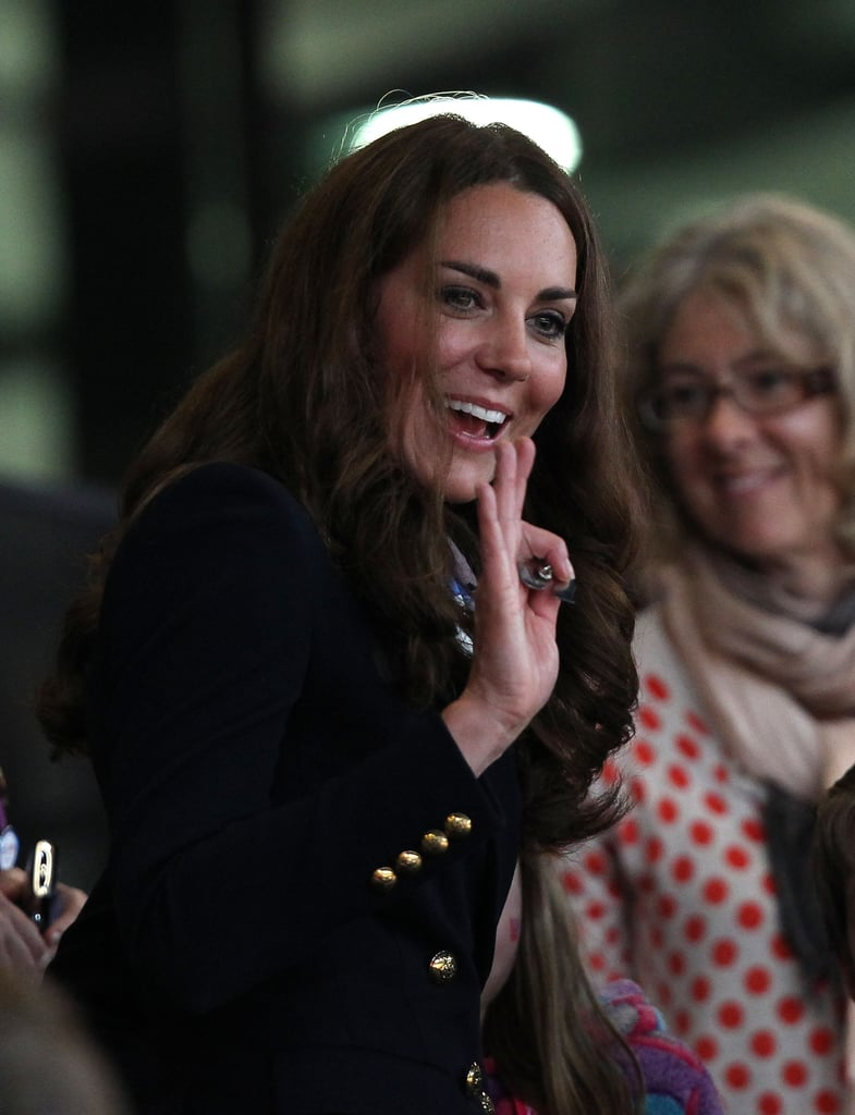 Kate Middleton wore an Emilio Pucci navy skirt suit to present medals on Sunday Sept. 2.