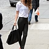 Lily Aldridge looked supersleek in a black leather Citizens of Humanity jeans, a crisp white Lily Aldridge for Velvet tee, and red cap-toe pumps in NYC. She completed her tricolored ensemble with a black tote bag, cat-eye sunglasses, and a shiny rhinestone necklace.