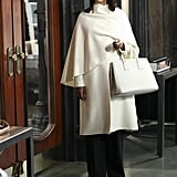 Olivia's chic, Ralph Lauren white coat is what our dreams are made of.