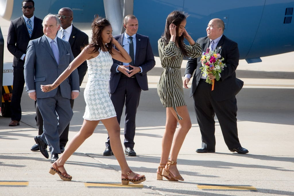 While getting off the plane in Spain, Sasha and Malia might as well have been strutting their stuff down a fashion runway.