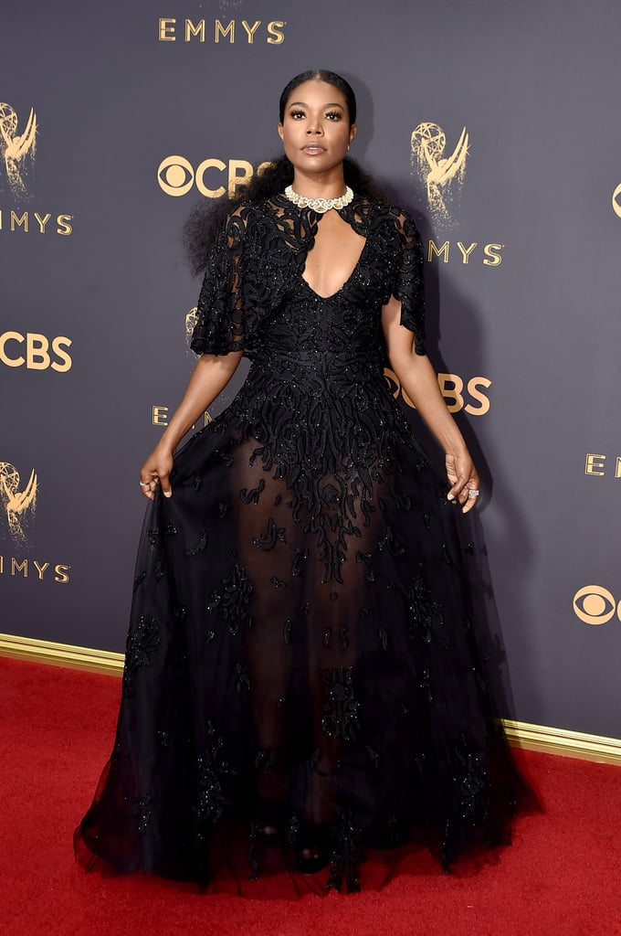 Judging by Gabrielle Union's red carpet look, she's taking her role as a presenter seriously . . . very seriously. Union stunned with her husband Dwayne Wade by her side in a  black beaded cape gown with a sheer full-length skirt from Zuhair Murad. The Being Mary Jane star topped off her look with a dazzling diamond necklace and strappy black Buccellati heels.