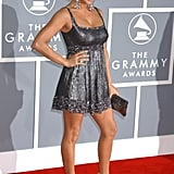 Fergie set the scene at the Grammys in 2007 — she hit the red carpet in a short silver Badgley Mischka frock, worn with a pair of silver sandals from her own footwear collection.