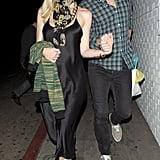 A glowing Jaime King showed off her bump in a slinky slip dress while out with her husband in Hollywood.