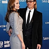 Brad Pitt gazed at Angelina Jolie as they posed for pictures at Cinema for Peace.