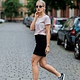 With a Simple T-Shirt and Black Miniskirt