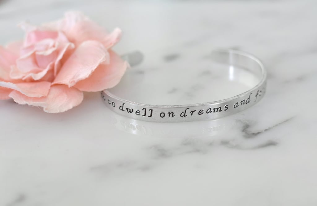 """It Does Not Do to Dwell on Dreams and Forget to Live"" Bracelet ($10-$12)"