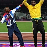 Gold medalist Mohamed Farah of Great Britain and Usain Bolt of Jamaica joked around on the podium.