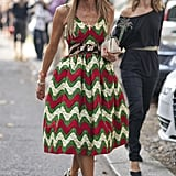 Anna Dello Russo went for the daytime drama in a printed, full-skirt sundress and animal print add-ons.