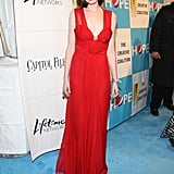 Anne called to mind a vintage screen siren in red for an event in 2009. The shade has become one of Anne's signature colours.