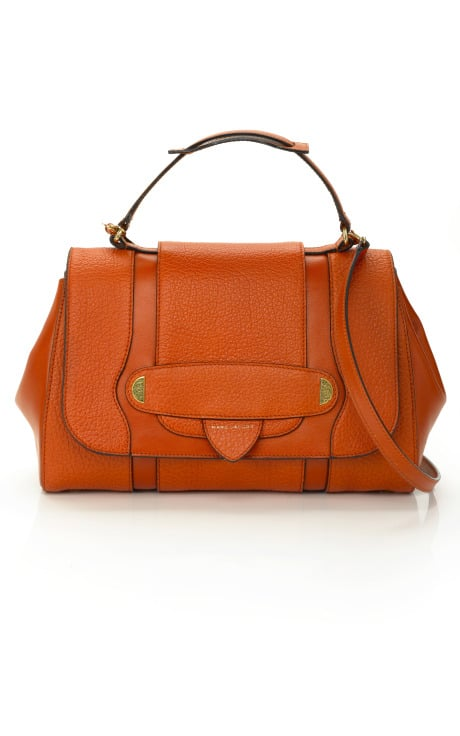 >> Here's a little peek at the bright and streamlined bags that populated the Marc Jacobs 2012 Resort collection. From flourescent lace iPad cases to blood orange satchels and metallic croc totes, we've got the full offering here — currently available for pre-order on Moda Operandi — just for your viewing pleasure.