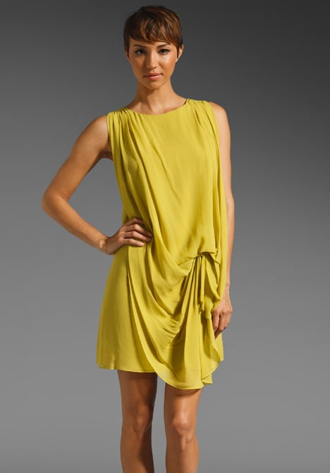 Chartreuse is a fantastic transitional color; it's bright and cheerful but still reads cool and autumnal. Throw on this draped dress with a wool coat, tights, and brown ankle booties for a cool-weather look with lots of pop. Halston Heritage Sleeveless Washed Silk Georgette ($375)
