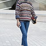 Once again Eva Chen added her Chanel flats to her Fashion Week look, this time in jeans.