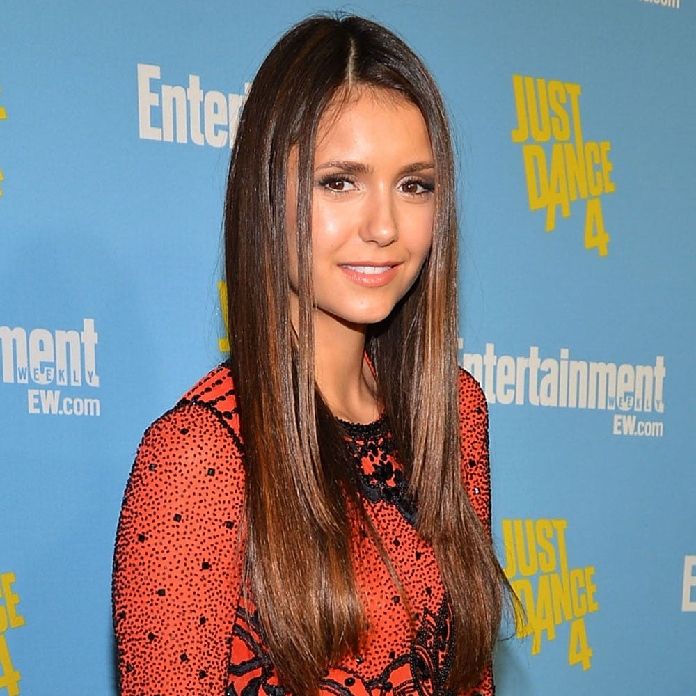 Nina Dobrev's sleek and straight hair looked the picture of health, and we loved her side part.