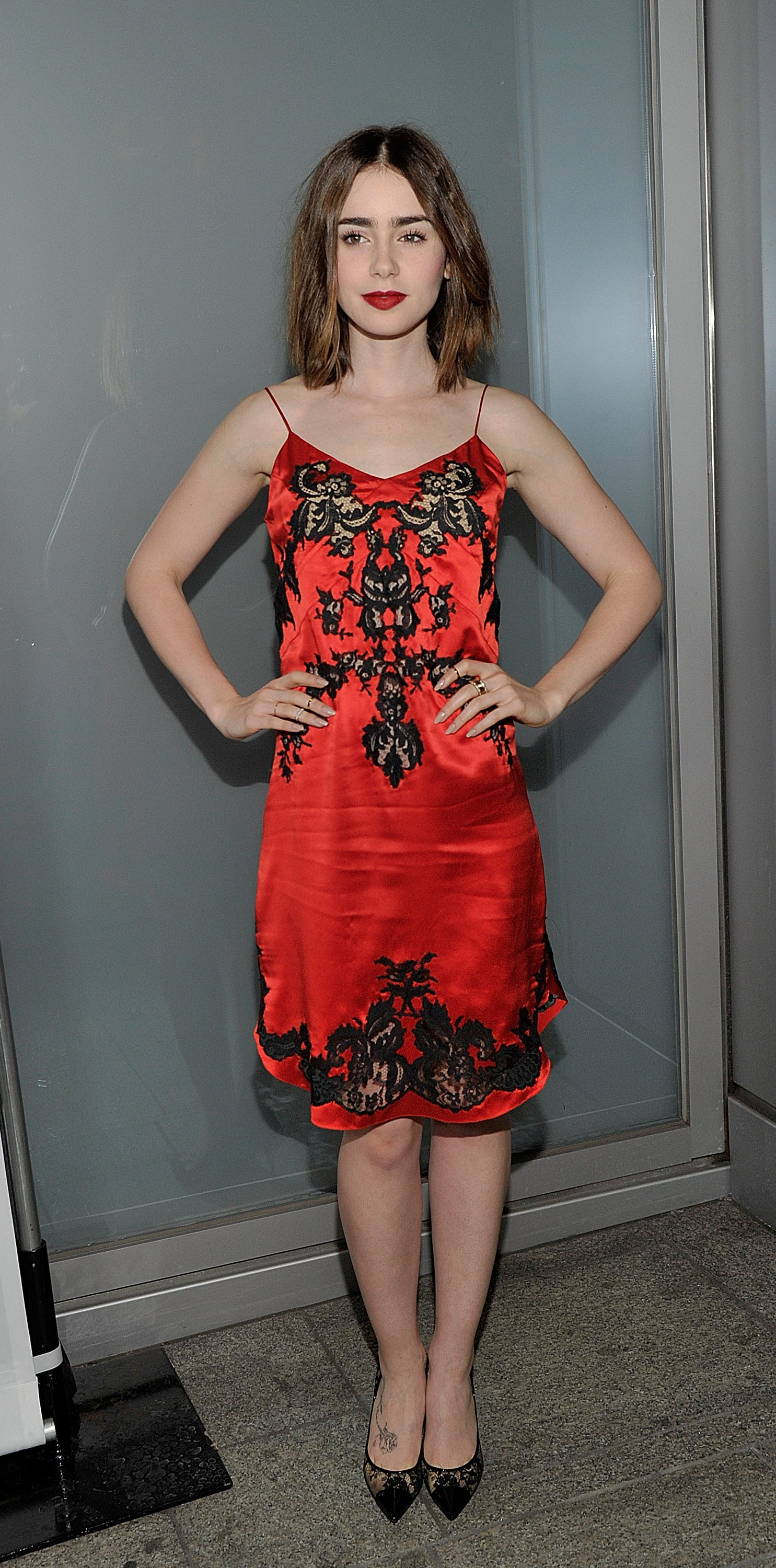 Lily Collins sported a red dress at Flaunt magazine's LA party.