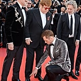 First, Taron Points Out Elton John's Untied Shoe