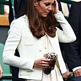 Kate Middleton fixed her hair while attending Wimbledon.