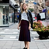 You'll look smart when you work a sophisticated skirt with a graphic t-shirt, leather jacket, and luxe loafers.